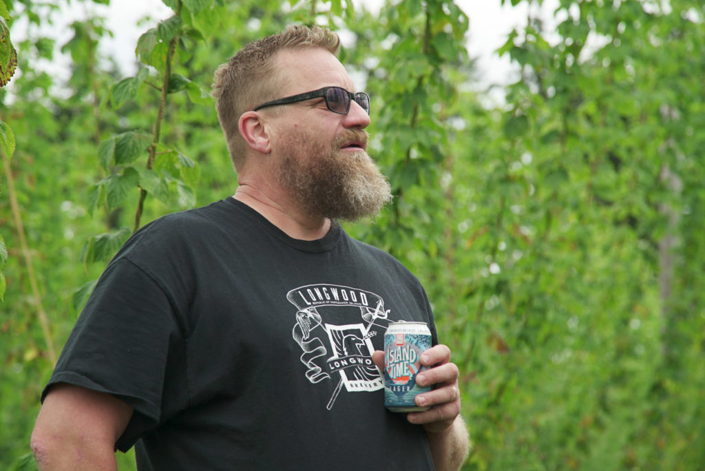 Harley Smith of Longwood Brewery checks out the hops growing near his brewery in Nanaimo.