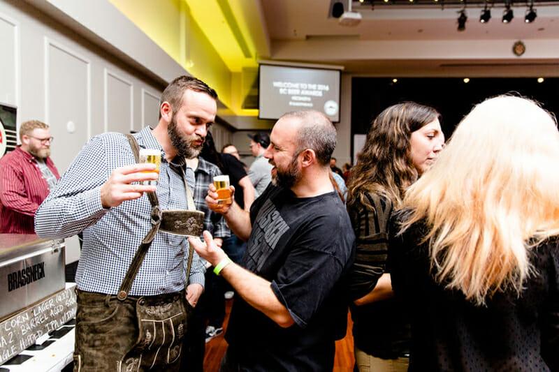 Nigel Springthorpe of Brassneck Brewery admires Main Street brewmaster Jack Bensley's lederhosen. (Photo: Alison Page)