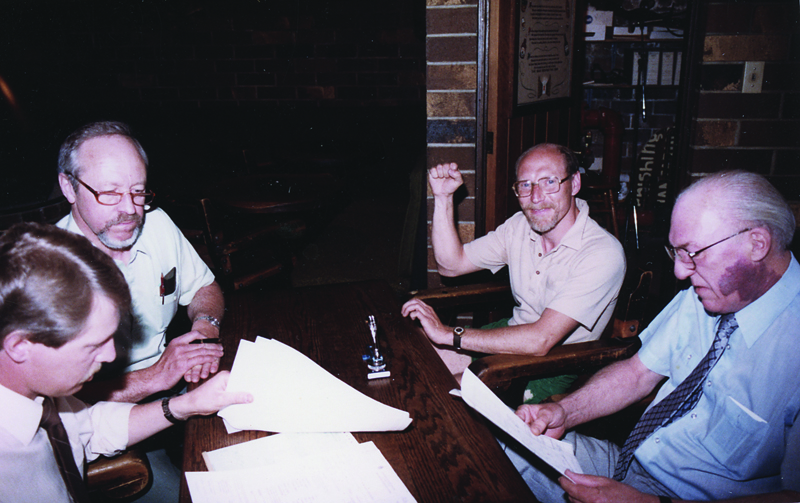 Frank Appleton pumps a fist as he and John Mitchell (top left) receive a federal licence for Horseshoe Bay Brewery in 1982. (Frank Appleton collection)