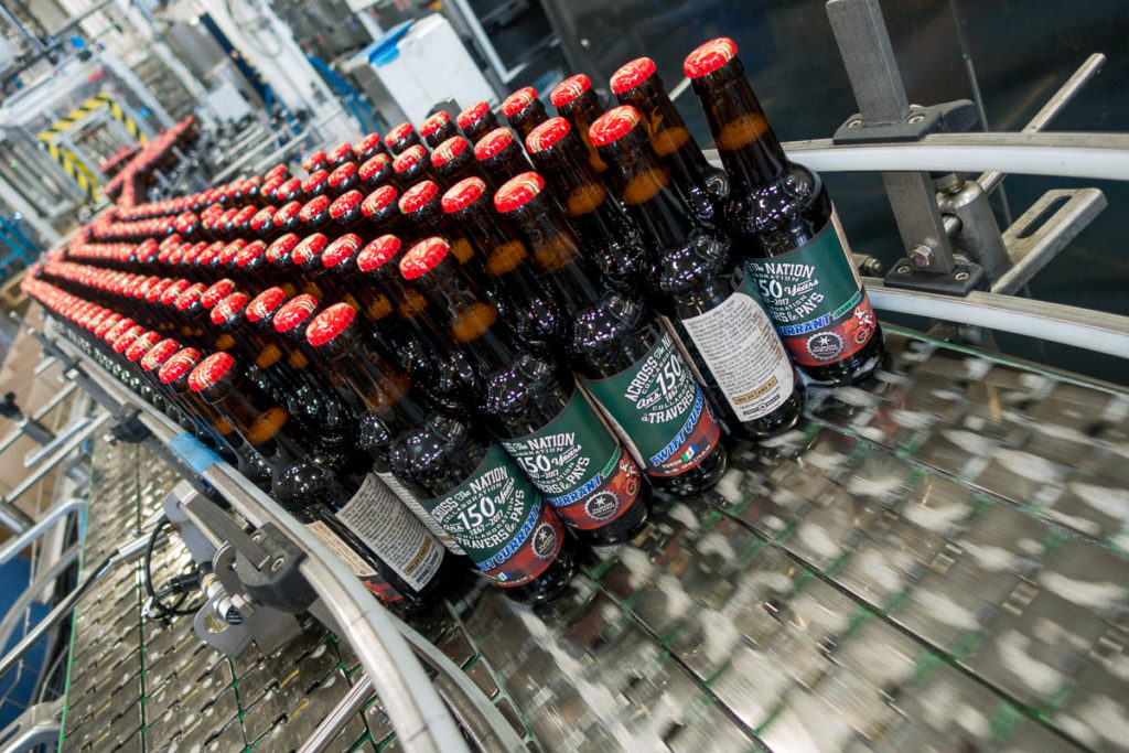 Bottles of Yukon Brewing's Swift Currant Dark Ale roll off the production line at Central City in Surrey.