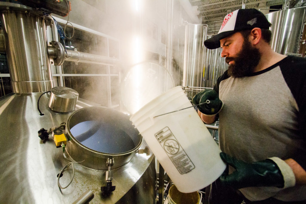 Chris Long of PEI Brewing gets hands on with Central City's brewhouse.