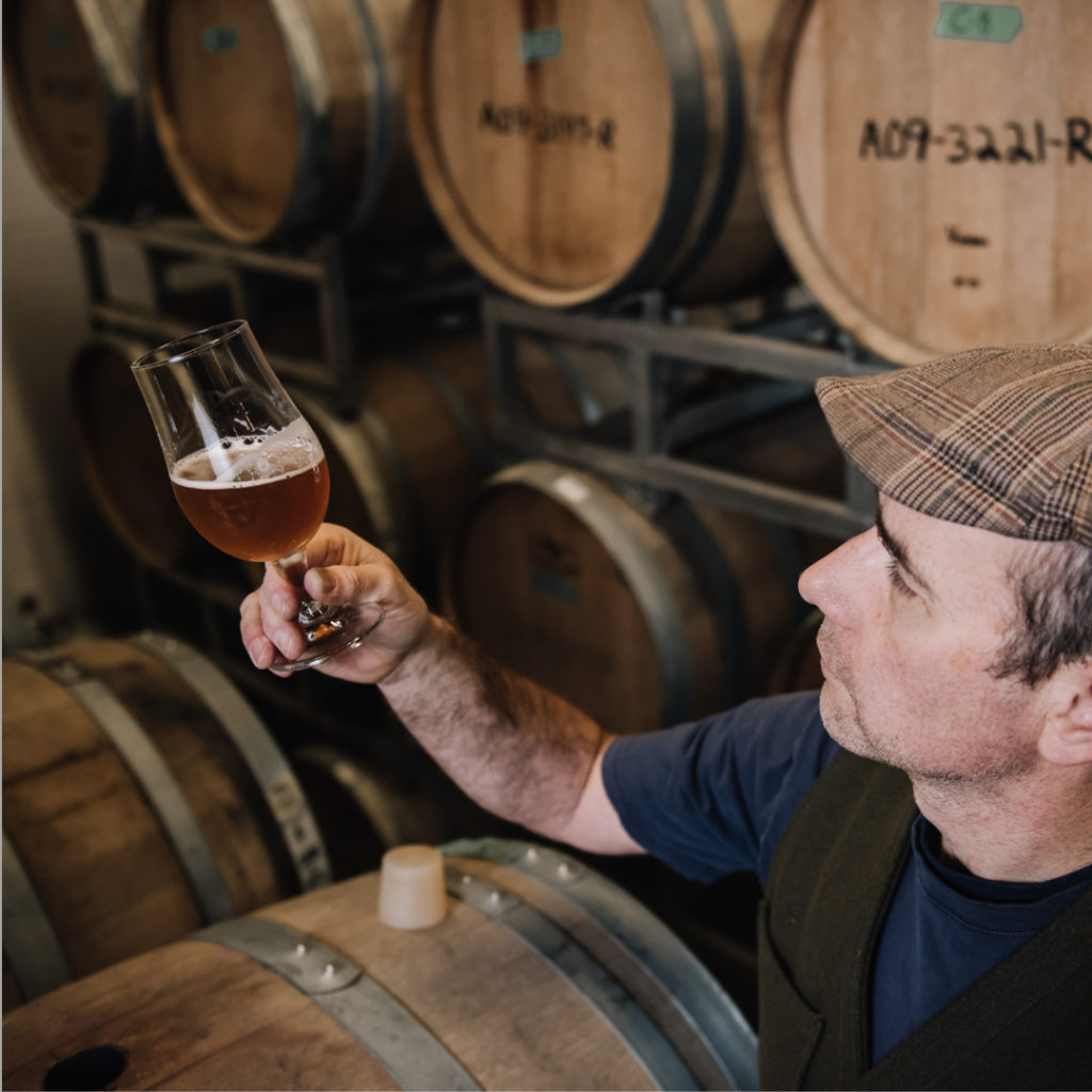 Iain Hill in the barrel room at Strange Fellows, photo credit Olga Zwart