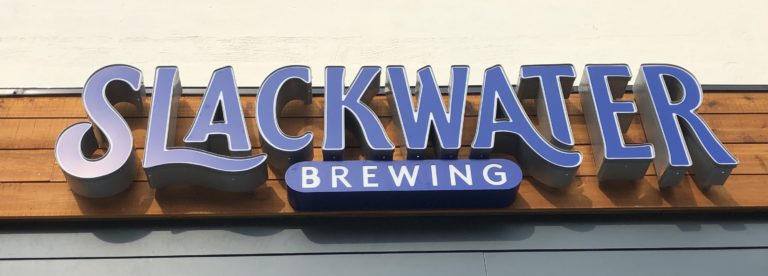 Outdoor signage at Slackwater Brewing