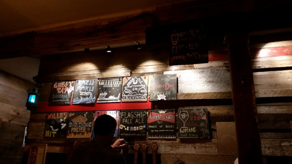 image of signs describing beers on tap at Wheelhouse Brewing in Prince Rupert, BC