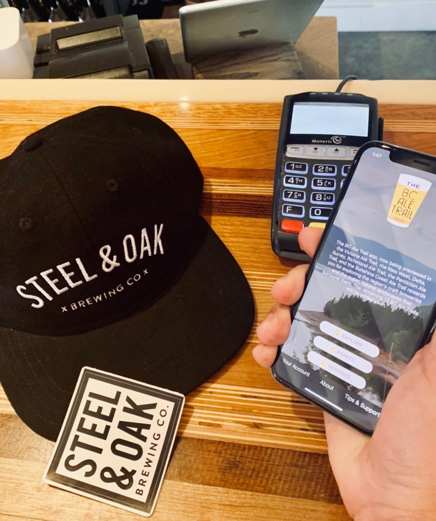 BC Ale Trail app in hand at Steel & Oak Brewing Co.