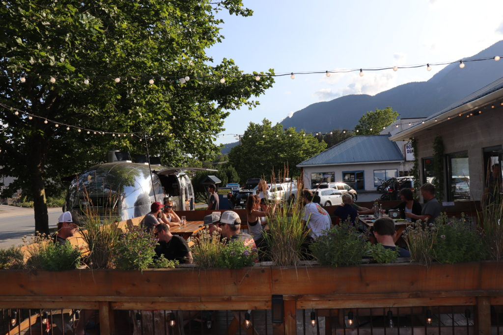 A-Frame Brewing's patio full of people in Squamish