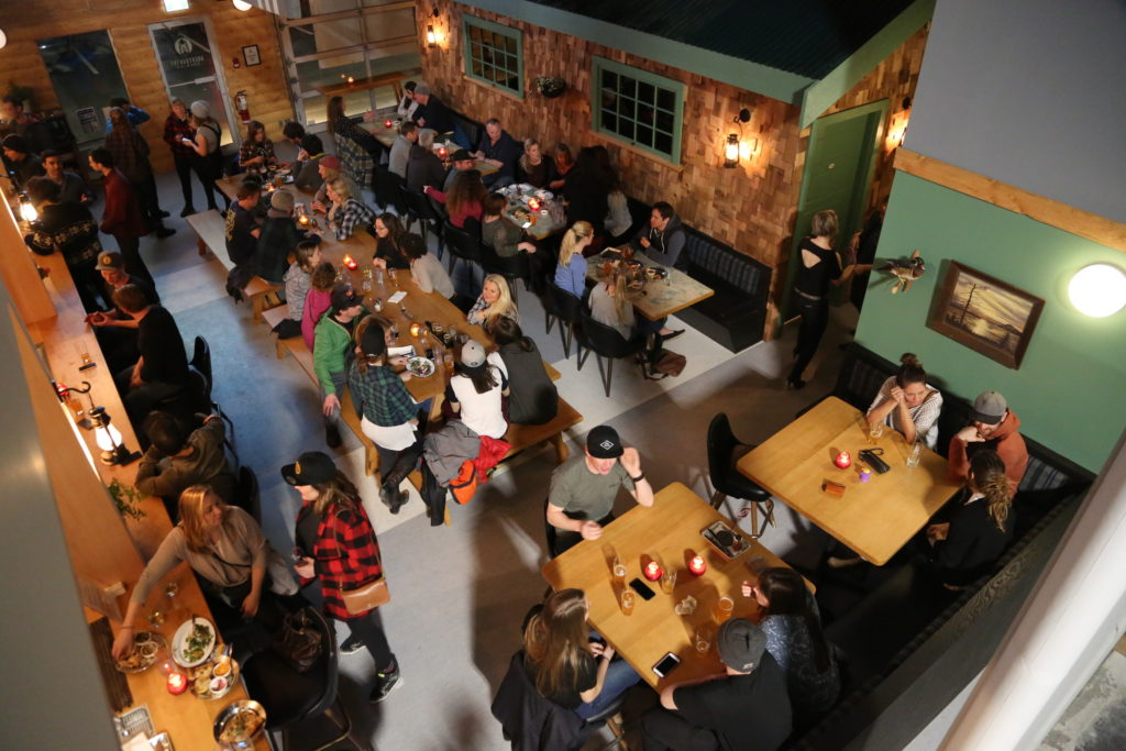people enjoying beers at Backcountry Brewing in Squamish