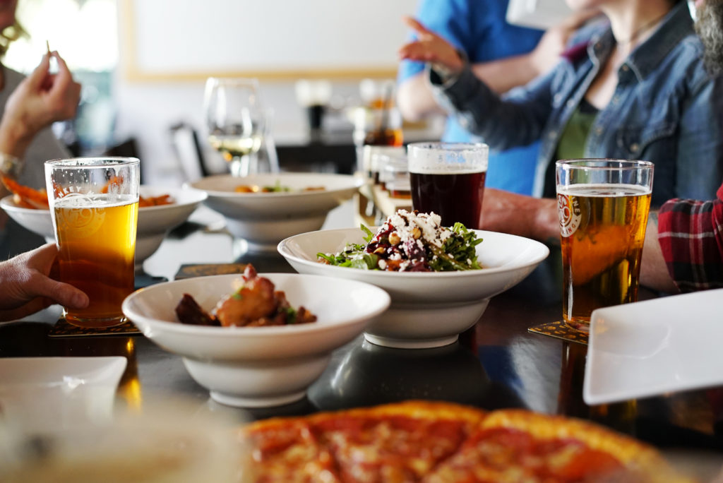 image of pizza, salad, and pints at Monkey 9 Brewing