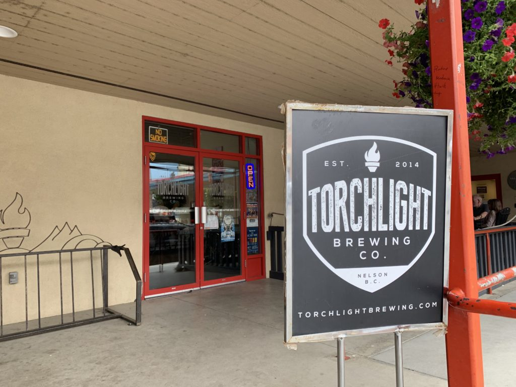 sign and front door of Torchlight Brewing Co.