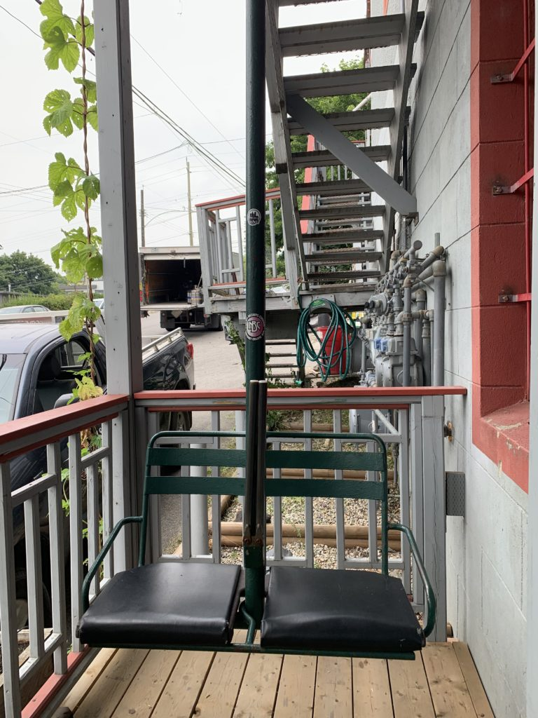 image of chairlift seat outside Nelson Brewing Company