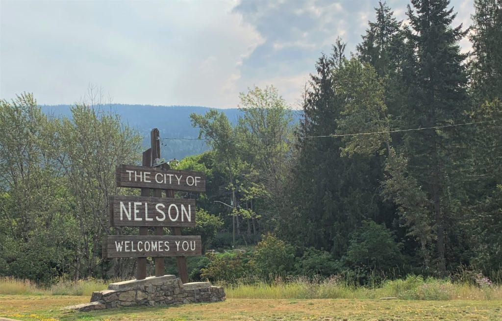 entrance sign for Nelson, BC says The City of Nelson Welcomes You