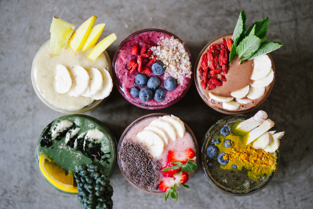 six smoothies with organic, dairy-free toppings from Green Moustache in Whistler, BC
