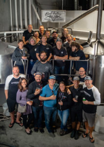 people posing for group shot for Penticton craft beer week's collaboration brew during BC Craft Beer Month