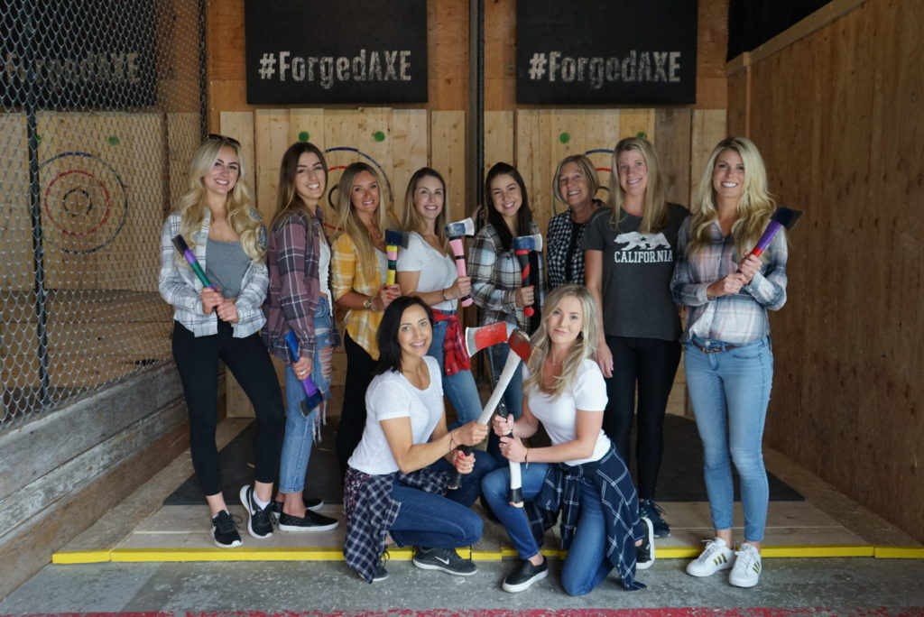 group of women wearing plaid and swinging axes at Forged Axe Throwing in Whistler, BC