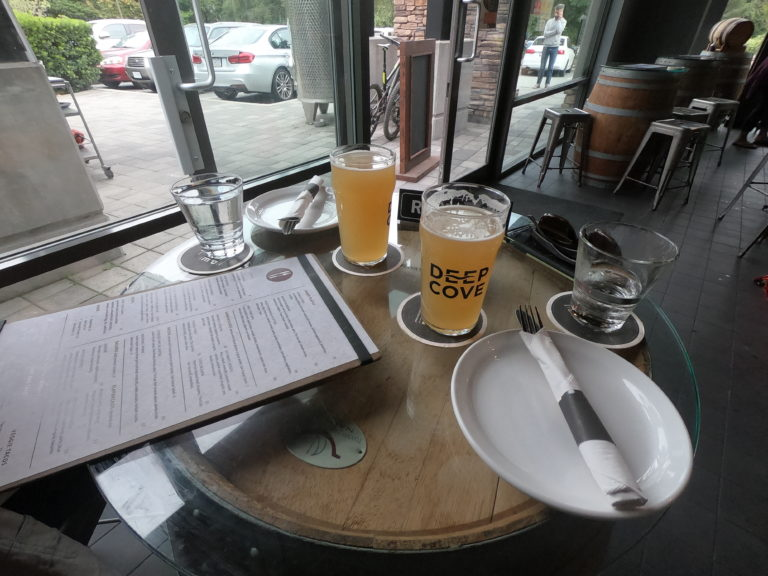 beers and menus on a table at Deep Cove