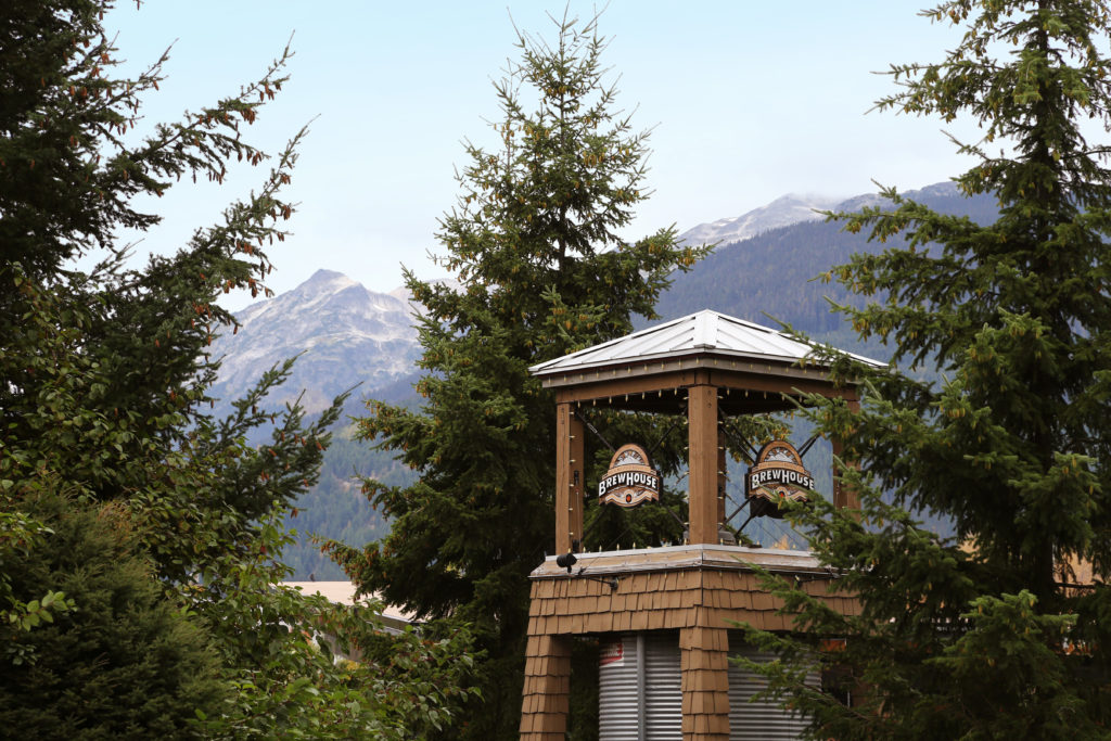 The Brewhouse tower in Whistler Village, with the mountains in the background