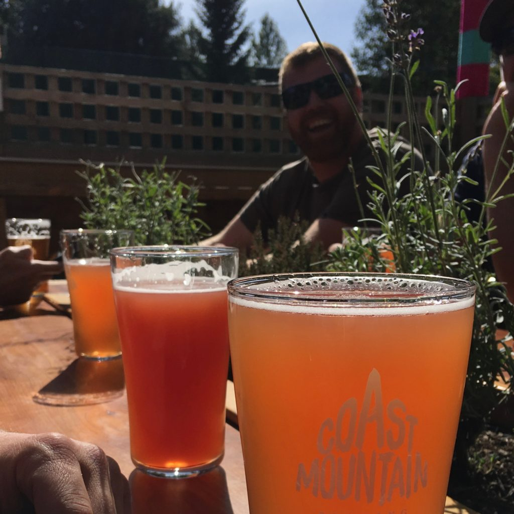 pints on a sunny day in Whistler at Coast Mountain Brewing