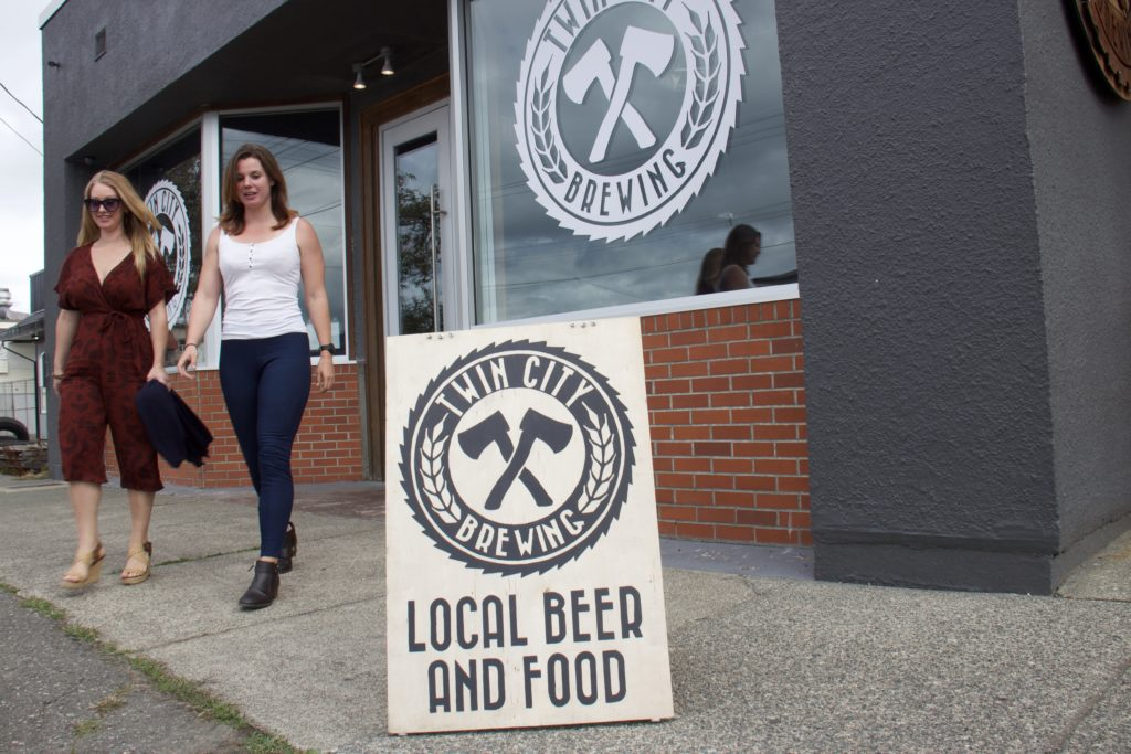 two women walking out of Twin City Brewing in Port Alberni