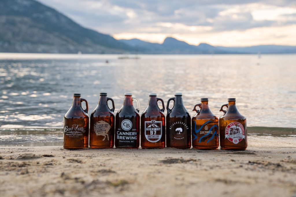 seven growlers from the seven breweries participating in Penticton Beer Week collaborative brew