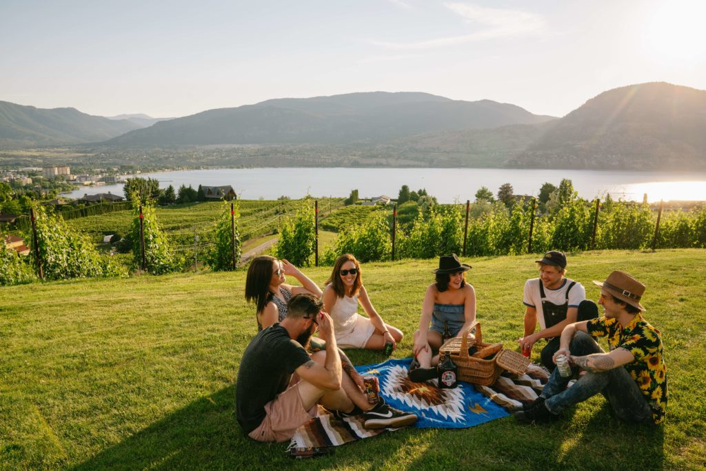 people enjoying a sunny picnic on the Penticton Ale Trail
