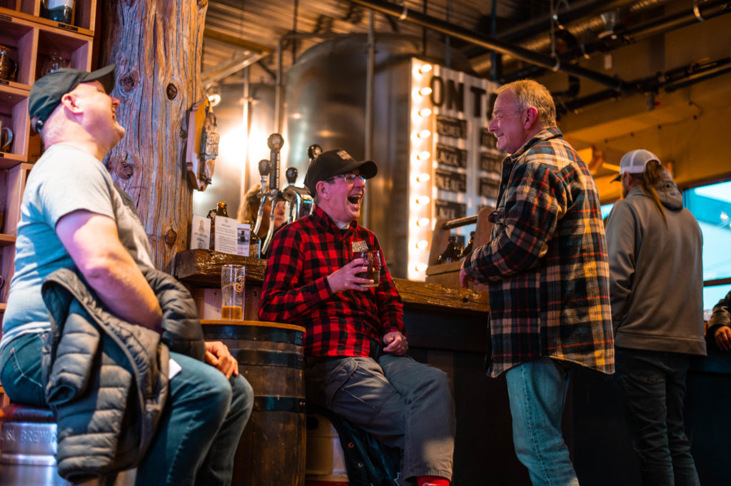 image of four men enjoying craft beer at Sherwood Mountain Brewhouse in Terrace on the Northern BC Ale Trail