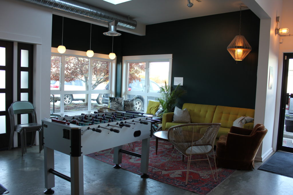 image of cozy couch corner and Foosball table at Land & Sea Brewing Co.