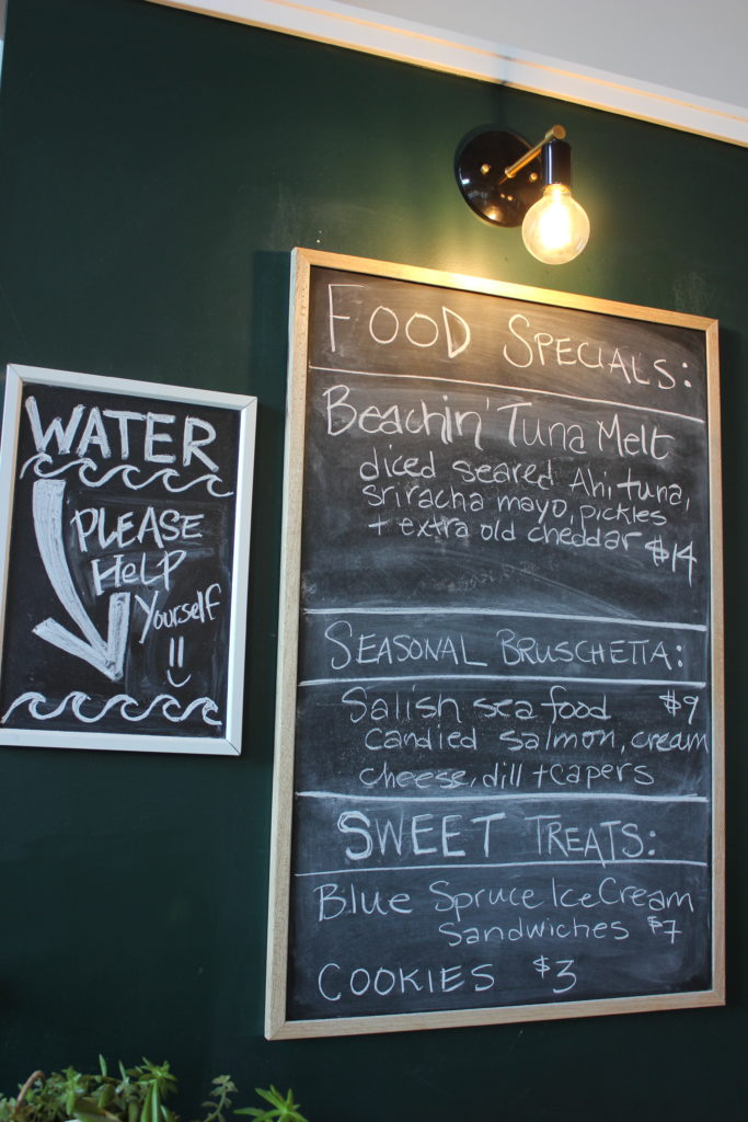 image of chalkboard sign featuring Land & Sea's food specials