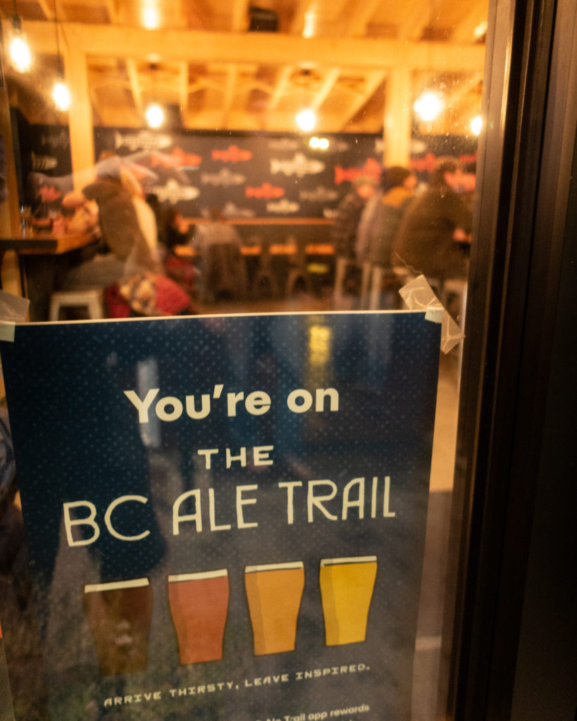 "image of ""You're on the BC ale Trail"" poster on the door at Smithers Brewing Company"