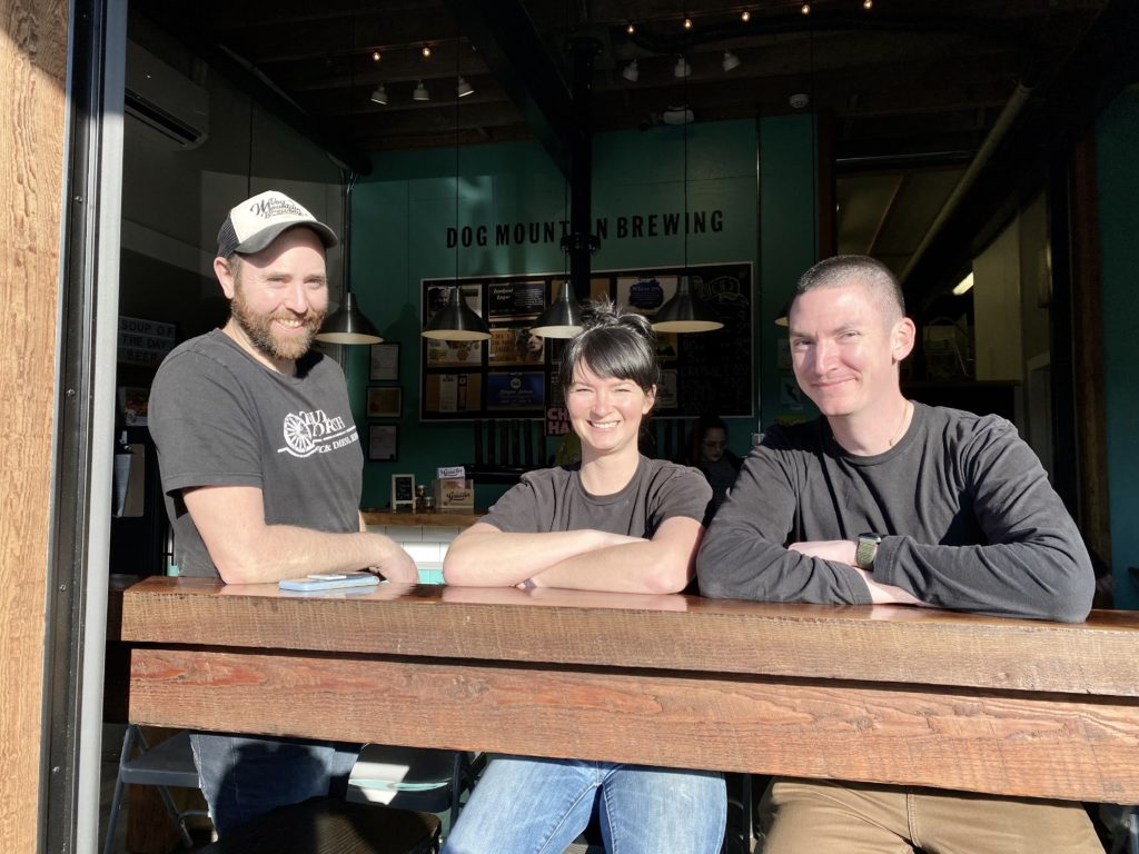 photo of Aaron, podcast host, with Andy Richards and Robin Miles, owners of Dog Mountain Brewing in Port Alberni