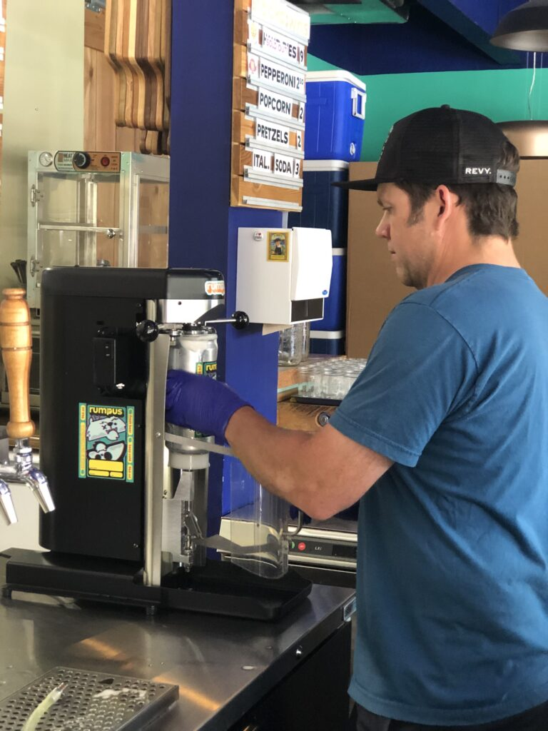 Fred filling a crowler at Rumpus Beer Co. on the BC Ale Trail