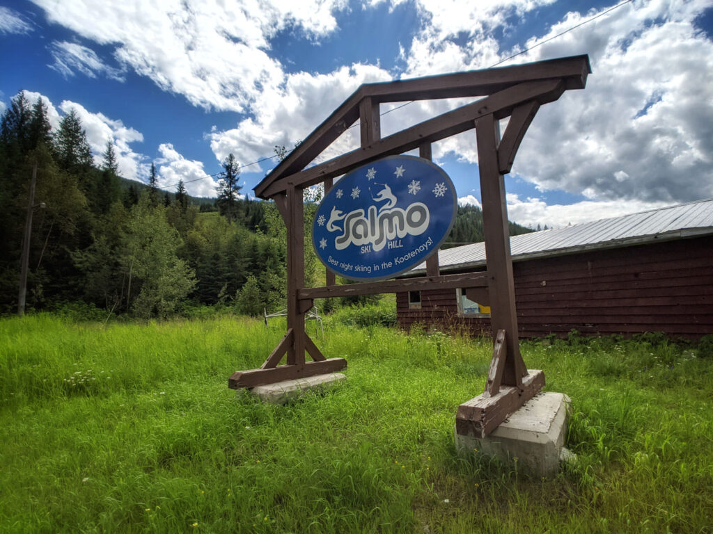 Salmo Ski Hill sign with landscape and sky
