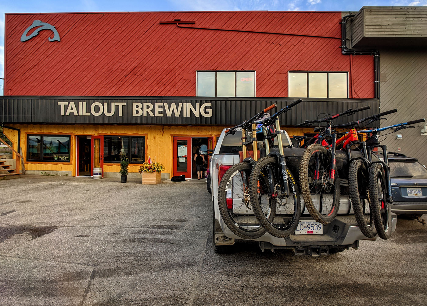 West Kootenay's Tailout Brewing parking lot with mountain bikes in truck