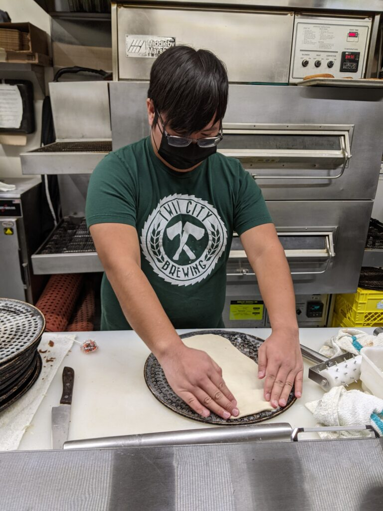 Pizza making at Twin City Brewing
